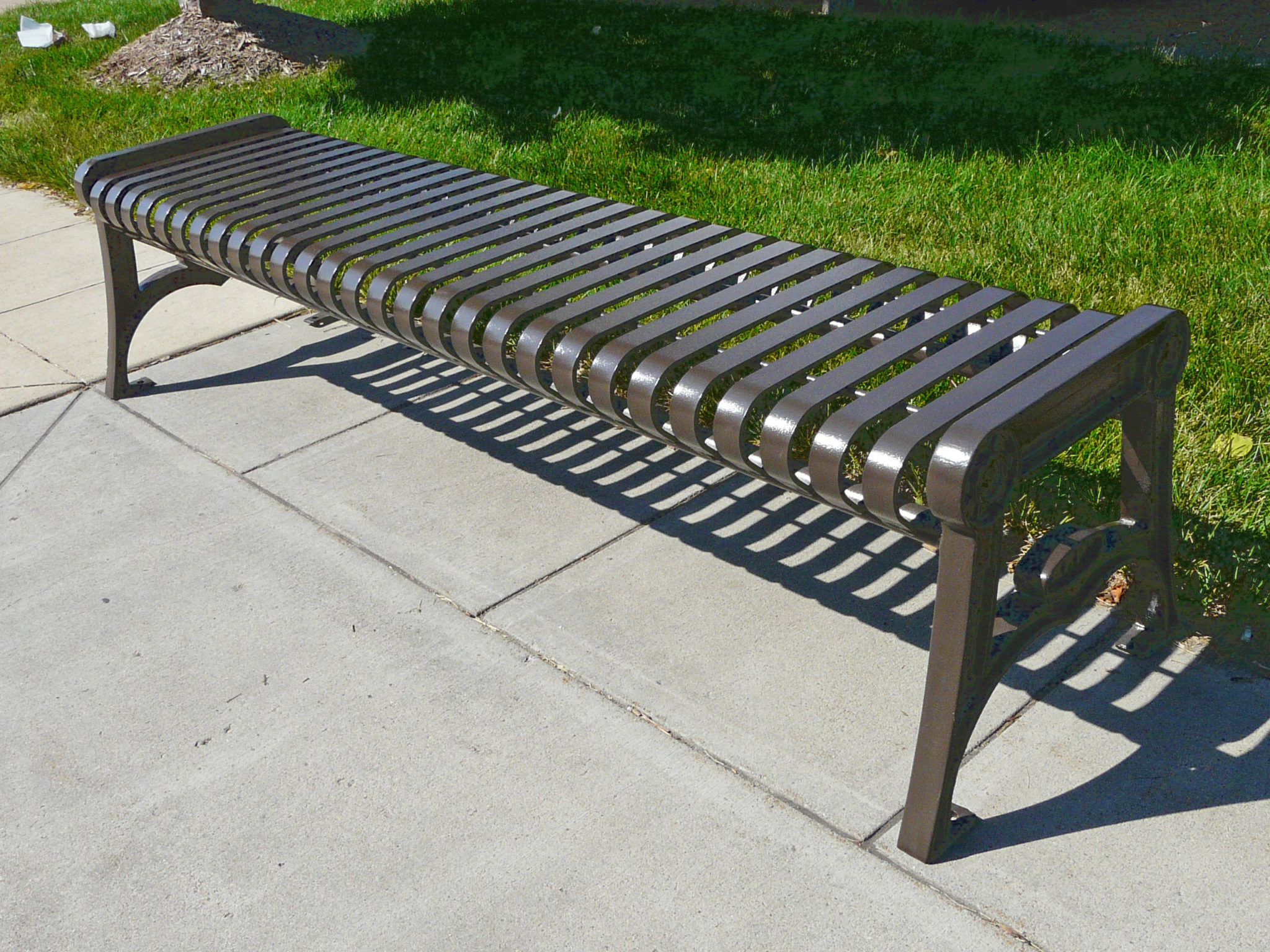 Manchester Vertical Slat Backless Bench With Cast Iron Ends Bison Inc
