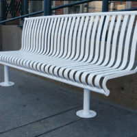 Manchester vertical slat backed bench with tubular mounting